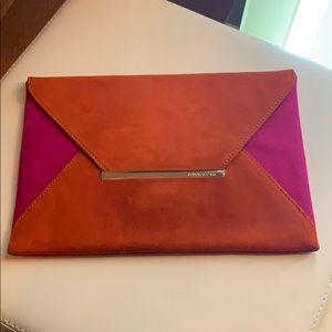Pink and orange envelope clutch